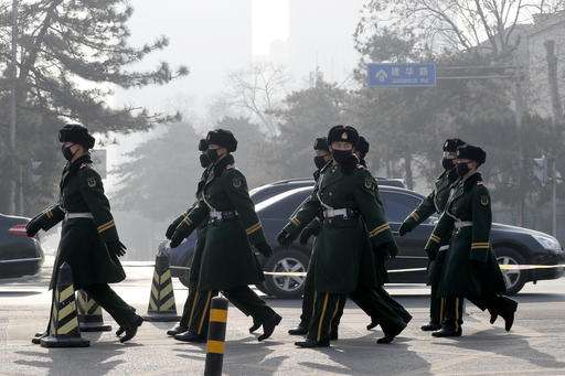 North China cities choked by smog shut factories, stop cars