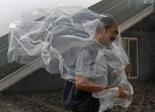 Over 50,000 evacuated in typhoon's path in southern China