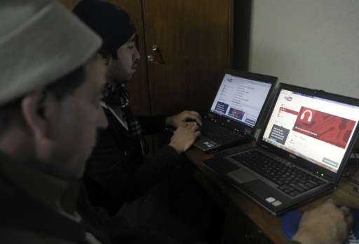 Pakistani computer users browse YouTube at an office in Quetta