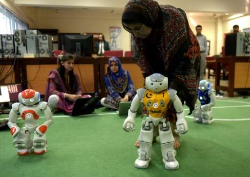 Pakistani students and team members of Robotics and Intelligence Systems Engineering programme their robot football players at t