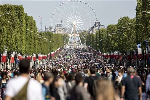 Pedestrians take over Champs-Elysees as Paris goes green