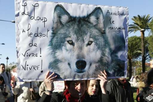 People take part in a demonstration of several wildlife conservation associations, to protest against the hunting of wolves, in