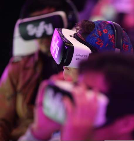 """People watch the virtual reality presentation of the SyFi network show, """"The Expanse"""" at the Consumer Electronics Show"""