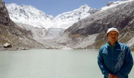 Peruvian mountan guide Saul Luciano Lliuya, stands in front of a lagoon that has formed at the base of the almost disappeared Ch