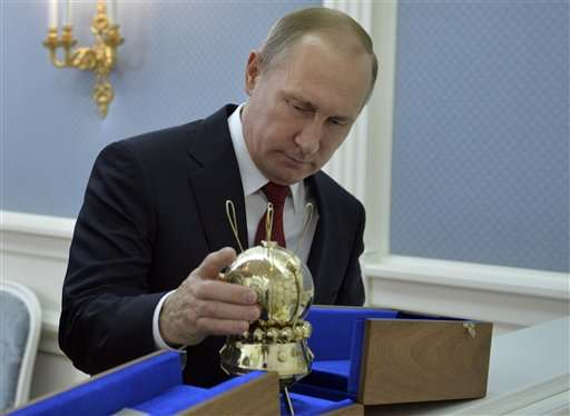 Putin plays up Russia-US cooperation in space