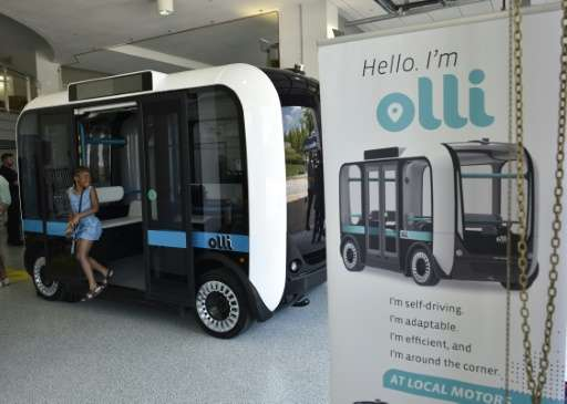 """Olli"" an autonomous shuttle is seen at the Local Motors facility at the National Harbor in Maryland on June 16, 2016"