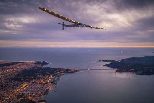 """Solar Impulse 2"", piloted by Swiss adventurer Bertrand Piccard, flies over the Golden Gate bridge in San Francisco, C"