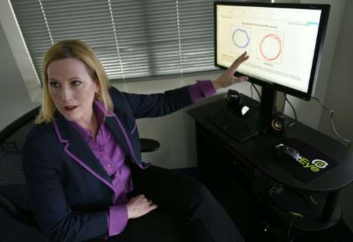 RightEye President demonstrates her company's eye-tracking technology at offices in Bethesda, Maryland