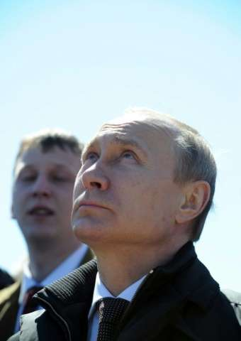 Russian President Vladimir Putin watches the launch of a Soyuz 2.1a rocket, carrying Lomonosov, Aist-2D and SamSat-218 satellite