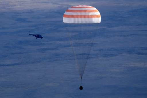 Russia's Soyuz MS space capsule, carrying the ISS crew, astronauts Kate Rubins, Anatoly Ivanishin and Takuya Onishi, lands in a