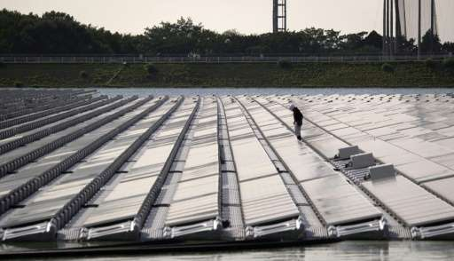 Scarcity of land has seen some solar farms in Japan built on water, such as this one near Yokosuka city