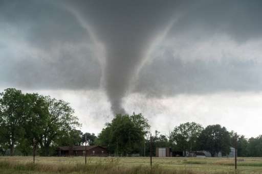 Several massive tornadoes have churned above and touched down in Oklahoma killing at least two