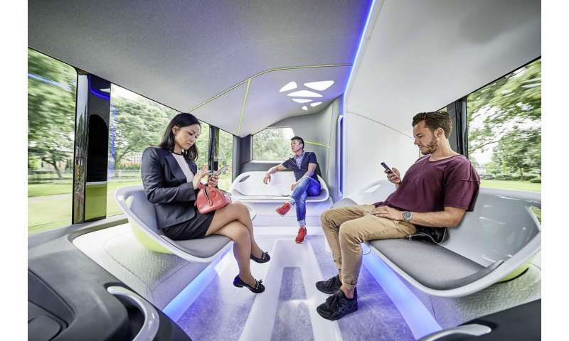 Smiling, hands-free driver sets comfort mood in Mercedes-Benz Future Bus