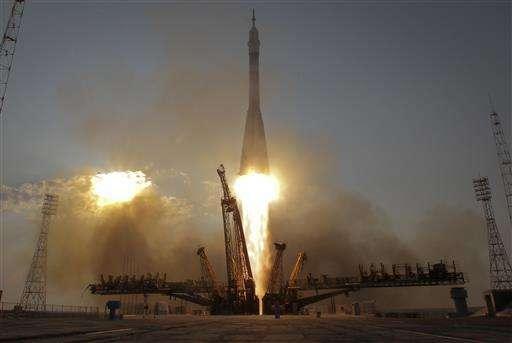 Soyuz capsule docks with International Space Station