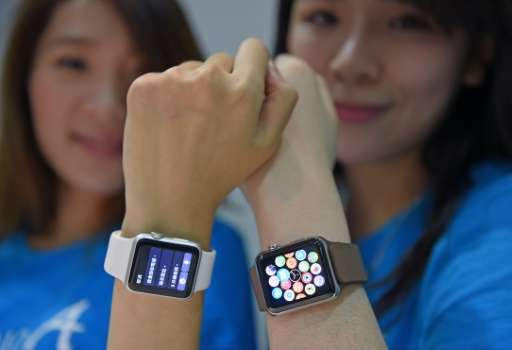 Staff at an Apple store display the company's new Apple Watch as it goes on sale in Taipei