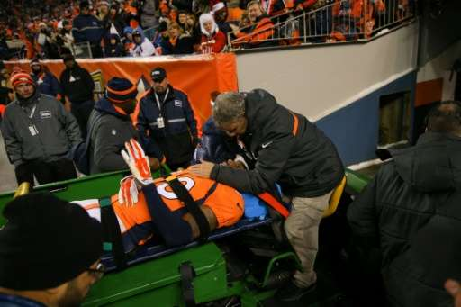 Strong safety David Bruton of the Denver Broncos is carted off the field after suffering a reported concussion