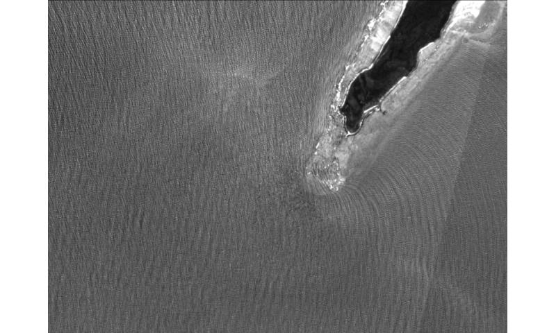 Sun glitter reveals coastal waves
