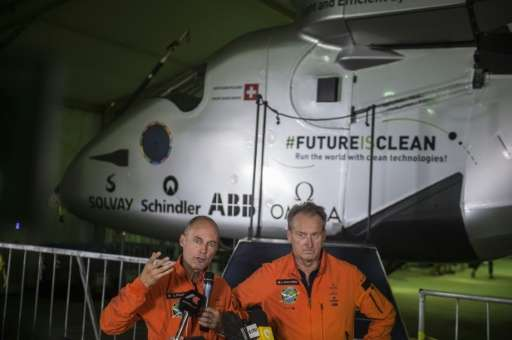 Swiss pilots Andre Borschberg (R) and Bertrand Piccard (L) took turns captaining the Solar Impulse 2 across four continents, two