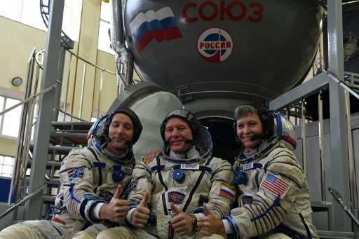 The crew heading to the ISS is composed of NASA astronaut Peggy Whitson (R), French astronaut Thomas Pesquet (L) and Russian cos