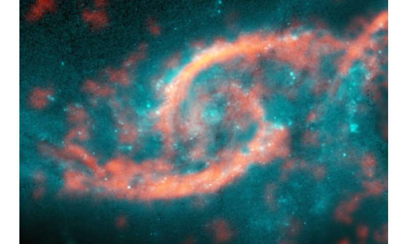 Tsunami of stars and gas produces dazzling eye-shaped feature in galaxy
