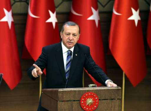 Turkish President Recep Tayyip Erdogan delivers a speech during a ceremony on the occasion of 171st anniversary of foundation of
