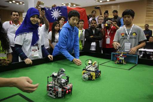 Two Taiwanese teenagers win World Robot Olympiad in India