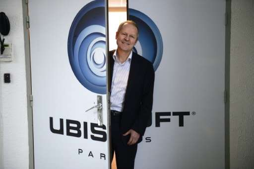 Ubisoft co-founder Yves Guillemot poses for a photo at the company studios in Montreuil, outside Paris, in 2013