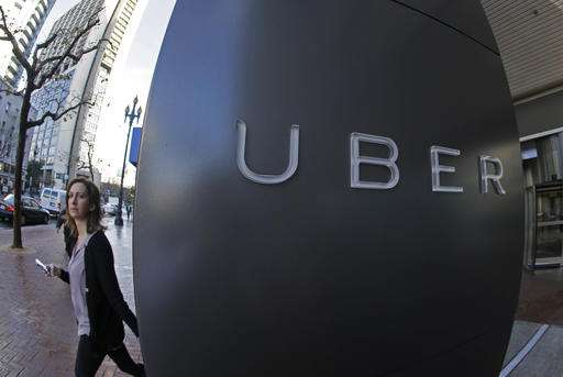 UK Uber drivers win case to get paid vacation, minimum wage