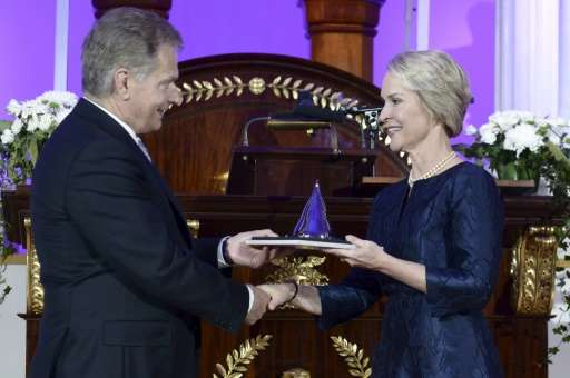 US biochemical engineer Frances Arnold (R) receives her Millennium Technology Prize 2016 from Finnish President Sauli Niinisto i