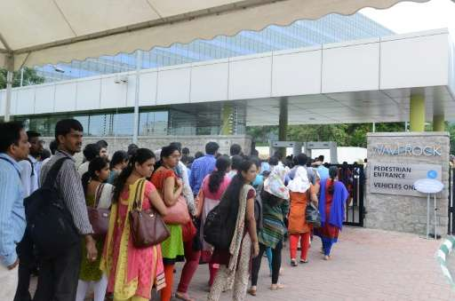 Visitors to the new Apple development office line up in Hyderabad on May 19, 2016