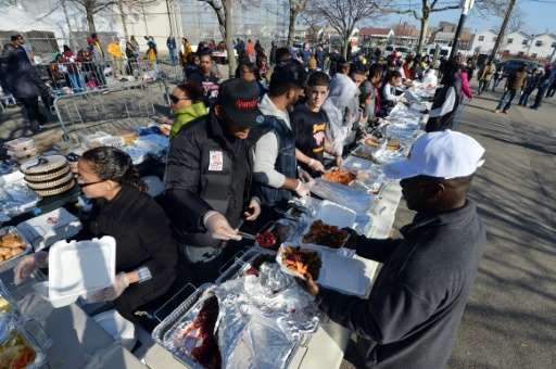 Volunteers serve Thanksgiving dinner to residents in the Rockaways section of Queens  in New York, as the city recovers from Sup