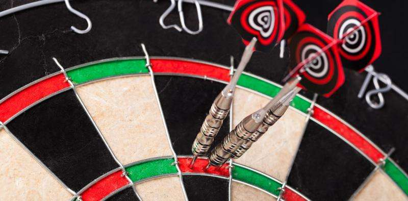 Why the dartboard looks like it does, and how bad players can do better