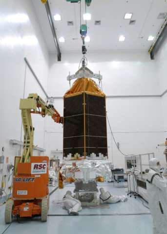Workers check the Kepler space telescope at the Hazardous Processing Facility at Astrotech in Titusville, Florida, on February 1