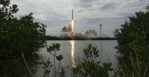 A SpaceX Falcon 9 rocket launches from NASA's Kennedy Space Center in Cape Canaveral, Florida in June
