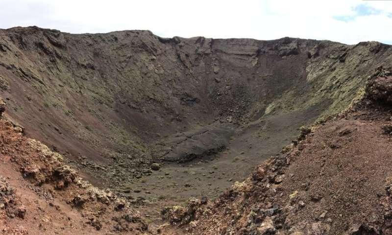 Astronaut meets volcano