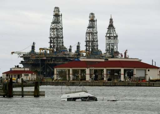 A sunken boat lies submerged in front of an oil rig after Hurricane Harvey hit Port Aransas, Texas