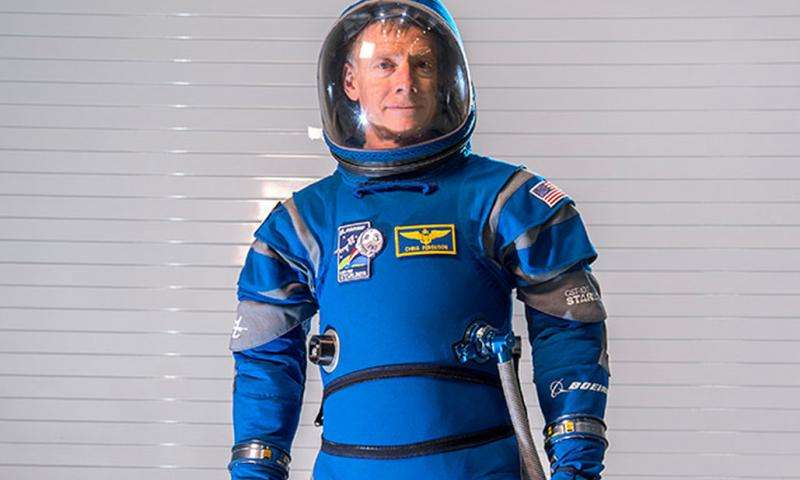 Boeing unveils blue spacesuits for Starliner crew capsule