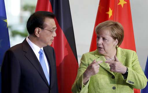 European leaders: climate change deal can't be renegotiated