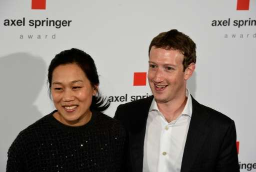 Facebook founder and CEO Mark Zuckerberg, seen in 2016 with his wife Priscilla Chan, says he can fund the couple's philanthropy