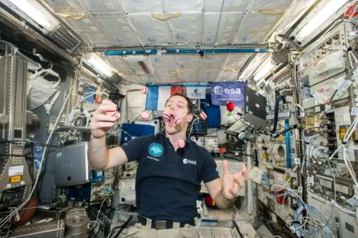 French astronaut Thomas Pesquet displays his juggling and eating skills  during a light moment on the International Space Statio