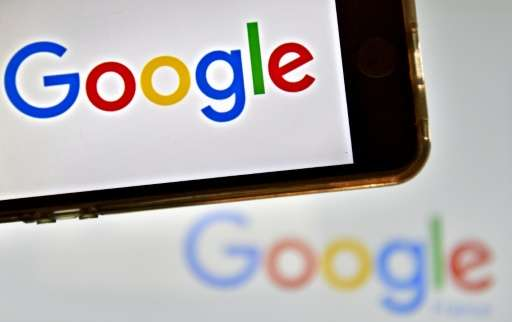 Google's parent company Alphabet says its quarterly profits took a hit because of a $2.74 billion anti-trust fine imposed by the