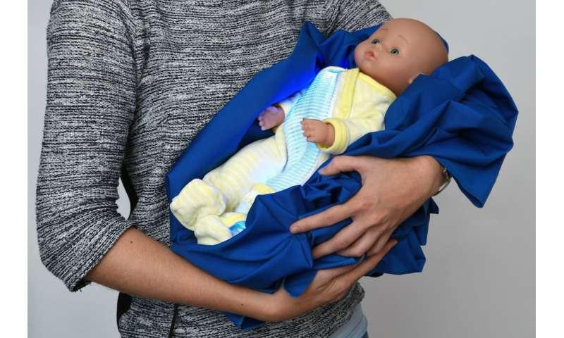 Illuminated pajamas treat newborns