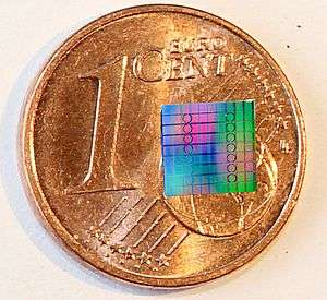 Optical communication at record-high speed via soliton frequency combs generated in optical microresonators