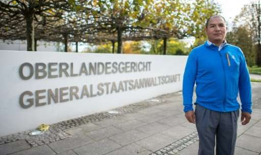 Peruvian farmer Saul Luciano Lliuya stands outside the higher regional court of Hamm, western Germany