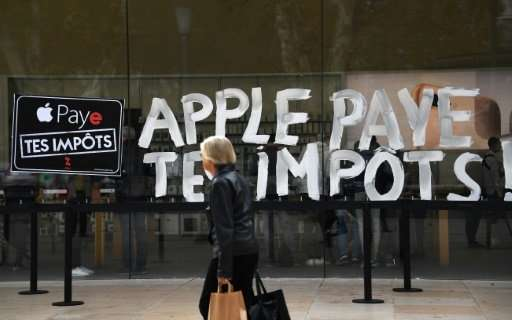"Protesters in France last week urged Apple to ""pay your taxes"" in a reference to its dispute with EU authorities over"