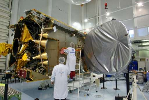 Technicians work on a satellite in an Intelsat cleanroom in Toulouse in 2004