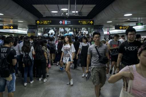 This picture taken on July 19 shows commuters during the morning rush hour at a station of the Shanghai Metro in Shanghai