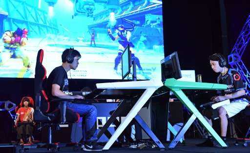 Visitors to the Tokyo Game Show are left in little doubt they are entering a male-dominated world.