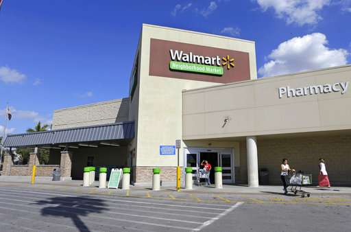 Wal-Mart's online sales surge, tops 1Q expectations