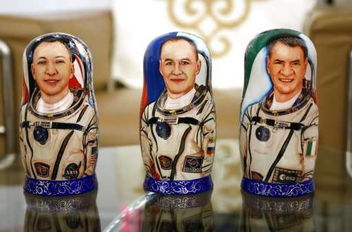 Space capsule with 3 astronauts returns to Earth